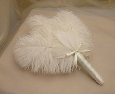 BRIDESMAIDS Cream Ostrich Feather by BridesDayRevisited I would add a rose Gold Center Brooch for a pop of sparkle.