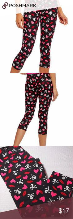 NEW Skulls / Day Of The Dead Leggings XS (01) I love these leggings! Skull and crossbones pattern. They're so colorful. Made of 95% Cotton, 5% Spandex, so there's lots of stretch. Colors are black background with multi colors of pink fuchsia red and white. A Beautiful combination that really works. Perfect for any Halloween event! Size XS Extra Small (01) NOBO Pants Leggings