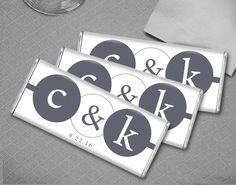 Monogrammed gray and white personalized wedding favors for a classy, upscale wedding reception. Add the custom wrapped HERSHEY'S bar to each guest's place setting or at your fancy candy buffet.