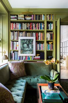 Inside a Designer's High-Style, Kid-Friendly Manhattan Apartment Rich shades of green feel luxurious and welcoming in this cozy home library reading nook. Cozy Home Library, Library Corner, Library Room, Library Ideas, Bookshelf Design, Bookshelves, Bookshelf Styling, Decor Inspiration, Living Room Green