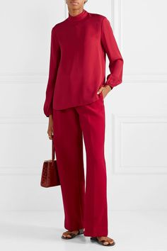 Bold yet elegant red look achieved with the relaxed cut of the shirt and pants.