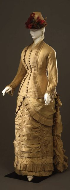 Walking dress in two parts (jacket and skirt), Italian manufacture (?), c. 1878-80, at the Pitti Palace Costume Gallery. Via Europeana Fashion.