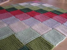 Garter stitch squares alternating knitted blanket