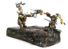 Duel between Ork and Librarian.