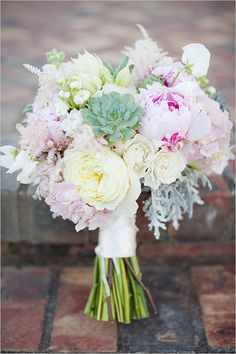 Just about perfect-- succulents, protea, peonies, dusty miller, garden roses etc.