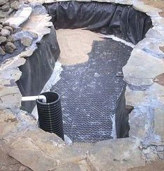 Undergravel filter with a 2 inch concrete slab under the filter plates and about 6 inches of # 8 filter gravel on top of it. #Ponds