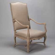 Tall French Arm Chair with Painted Frame  --  Circa 1900 tall French armchair with high upholstered back, carved details on the arms, legs and apron, and new neutral-colored upholstery with decorative nail heads.  --   Item:  6143  --  Retail Price:  $3995