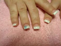 Gel nails white tips blue daisy on ring fingers