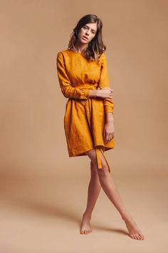 """Hand crafted pure linen dress. This dress is not just a dress, its a statement. Warm yellow color, pure linen and unusual design - everything makes it one-of-a-kind. It was crafted to make you feel confident, to empower you. DETAILS: Model hight: 5`8""""(176 cm) Model measurements: bust - 34"""", waist - 22"""", hips - 35"""" - 100% linen - Available sizes: S, M, L - Color: Warm yellow (color may look different on different displays, because of their settings) Dress length: 25"""" (92 cm) Sleeve le..."""