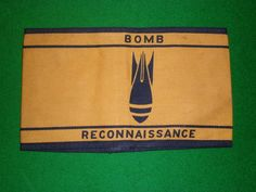 Printed cotton armlet for trained Civil Defence Bomb Reconnaissance Officers. Authorised for wear in 1942 the armlet was worn by those CD personnel who had passed the regional BR course. Their job was to positively identify UXBs before they were assigned to the Royal Engineers BD teams.