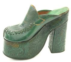 Dark green platform right shoe, made in the 1970s, labelled 'Sacha'.