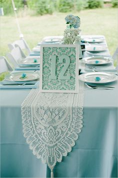 blue and white lace table numbers and decor