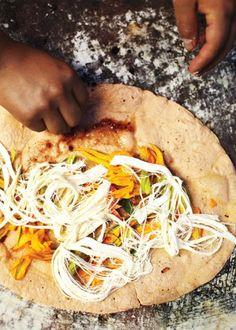 The REAL quesadilla. Queso de Oaxaca and squash blossom served piping hot in the Central de Abastos. via Conde Nast Traveler./ Quesadilla con queso oaxaca y flor de calabaza y epazote