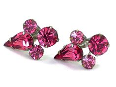 Pink Rhinestone Dainty Cluster EarringsIn Silver Tone With Screw BacksAll prong set on raised-mount settingattached via rivets. Likely foil backe...  #clip-on #pink #silver