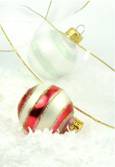 Shimmery glass ball ornaments and sheer wire framed organza ribbon