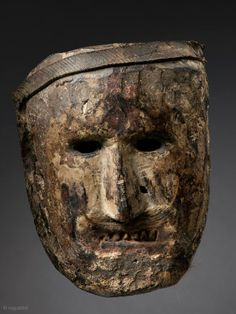 Shamanic Mask, Middle Hills, Nepal, Wood, pigment, rubber strip, fur, 18th/19th Century, Published: Masks of Fabled Lands, 2009 plate 57, 9 in/23 cm.    A heavily patinated hardwood mask with an uncommon white-pigmented face.