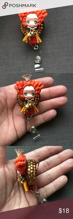 """Red Queen Clay Badge Reel Alice Through the Looking Glass Clay Bling Restartable Badge Reel  This nurse badge reel would make a perfect nursing gift for a special nurse,student, Health Care Workers,  or if you're a nurse, for your coworkers at the nurses' station!  The reel measures 1 1/4"""" in diameter and cord stretches 28  Red Queen is about 1 7/8""""  Please note - these badges are NOT lightweight. Pick one Badge Disney Accessories Key & Card Holders"""