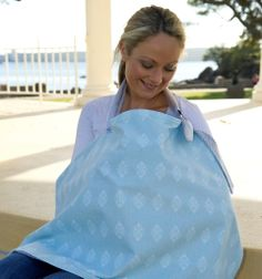 Kiss Kiss Hug Hug Victorian Blue breastfeeding cover. Provides privacy for anxious mums wanting to breastfeed in public and also helps keep bub focussed on the job :)