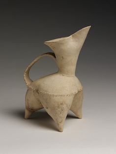 Incredible attitude! Tripod ewer (c.2500 BC) from the Shandong province in China. white earthenware (pre-porcelain). via Victoria & Albert Museum
