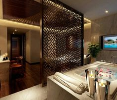❤ Master Bathroom idea. Love the screen with seating on other side  and ambiance lighting on ceiling