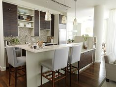 Chic Condo Kitchen Exotic Wood Cabinets Set The Tone Of This Design. In  This Sleek Space Designed By Designer Sarah Richardson, Host Of HGTVu0027s Part 39