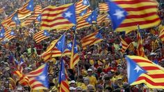 People hold Catalan separatist flags during a protest in central Barcelona - 11 September 2014. Catalan independence: November referendum 'called off' The Catalan regional government has called off plans to push ahead with a contested independence referendum, Spanish media says. Hundreds of thousands of Catalans have protested on the streets in recent weeks, demanding their own vote. #Catalan #Catalonia #Spain #Spanish #independence #referendum #politics #EU