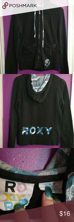 Black roxy zip up juniors I'm moving and all must go by the end of August throw me an offer. Black Roxy zip up in good condition size juniors medium. Close up pictures included of the pockets and design. The button on pocket isn't functional just for design. Please ask any questions that you may have. Roxy Tops Sweatshirts & Hoodies