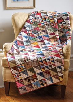 """""""All Together Now"""" is a fat quarter friendly quilt pattern. This throw size quilt features triangle squares in four sizes and is the perfect scrap quilt to use your stash."""