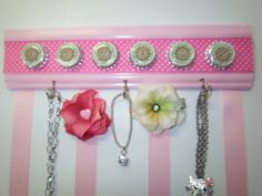 maybe  purchase hook rack, decorate, staple ribbons to back for hair clips?