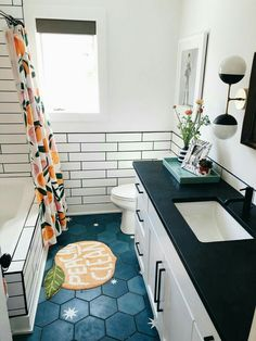 black and white subway tile guest bathroom with black counters and brass lightin. black and white subway tile guest bathroom with black counters and brass lighting. Peach Shower Curtain, My New Room, House Rooms, Sweet Home, New Homes, House Design, Interior Design, House Styles, Black Counters