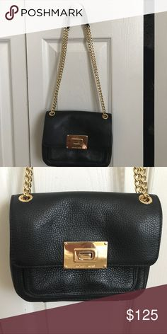 Michael Kors purse Cross body/shoulder mini purse 3 pocket with 2 zipper compartments.  Perfect condition no marks inside or out. Black lining Michael Kors Bags Crossbody Bags