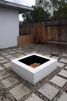 white, painted inside black, simple firepit