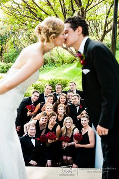 Stand on top of a stairway with your bridal party between the two of you as you kiss!