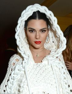 Fashion forward: Kendall  styled her brunette locks into chic centre-parted chignon