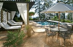 Decomposed granite around the pool patio instead of grass. Love it in drought stricken Northern California