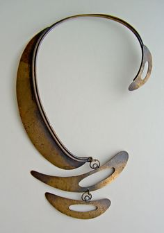 "Art Smith – at the Brooklyn Museum | This iconic design, the ""Patina"" necklace, (shown in past publications,) Smith is obviously referencing the modern artist Alexander Calder and his mobile creations. However, Smith took that inspiration and created a unique sensual and primitive form that embraces the neck of the wearer almost as a snake would hug the neck of its handler."
