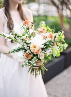 green and peach bouquet, photo by Jen Huang http://ruffledblog.com/intimate-wedding-at-the-foundry-in-brooklyn #flowers #weddingbouquet