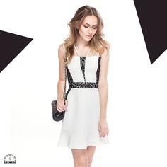 O branco e preto em uma mistura de texturas: renda e jacquard. A saia peplum, todas estas são tendências nesta estação!