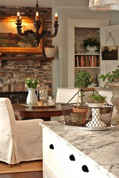 love! glamorous dining room, fire place, cupboard with cute door swung open with art on inside