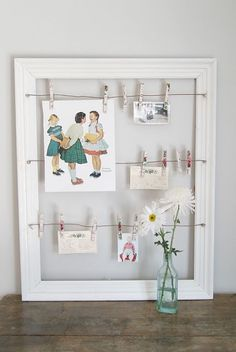 I remember seeing frames like this at Christmas-time to use for holding cards - but I love the idea of using it to show off pictures of the bride/groom. or it could go on the gift table, and ppl could put their cards there instead of in some sort of container (luggage/birdcage, etc).