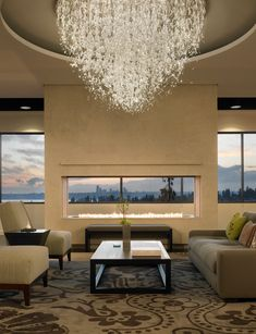 See through #fireplace and windows and a beautiful chandelier. What about the view! #loungeroom