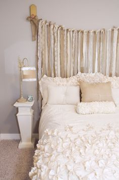 whimsical alternative to a headboard- ribbon! Love this idea!