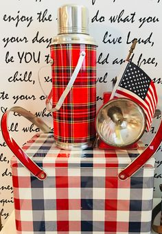 I like this checked tin picnic basket along with my vintage thermos and flashlight to add lots of color to my patriotic decor
