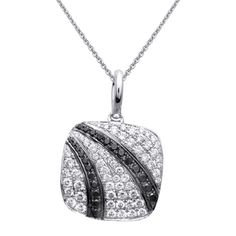 Midnight Collection - This glimmering 18K white and black pendant is comprised of .64ctw round white Diamonds and .22ctw round black Diamonds. - TP297