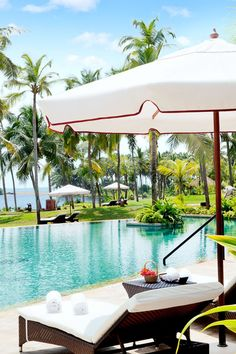 The pool is surrounded by palm-studded gardens. #Jetsetter