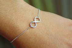 Eternity symbol.  Love it.  Can't commit to a tattoo.  Here's my answer. Lol.   NEVER ENDING STORY 2  Sterling Silver by Smallpackagesjewelry, $22.00