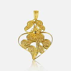 Viana's Heart Variation  88€   Silver 925 - 19K Gold plating H. 6.88 cm x L. 3.98 cm 2 to 3 weeks from purchase Available in gold, email us for more information  Handmade with love