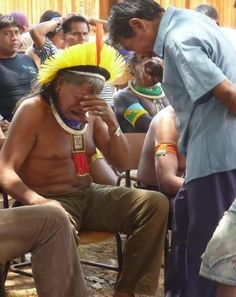 Chief Raoni of the Kayapo usually captioned as crying at the news Brazil had given approval for a dam to be built, driving them from their land. The Chief says he was NOT crying because of the decision but had been reunited with a family member at this meeting. http://www.snopes.com/photos/politics/kayapo.asp has story & sources.