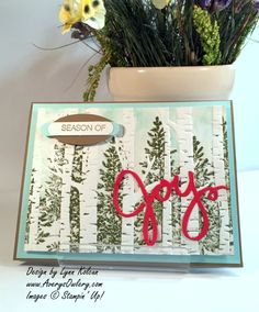 Brayer light blue on embossing folder, then stamp pine trees in dark green.  Beautiful!