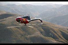 Stunt pilot Chuck Aaaron performs breathtaking stunts in his aerobatic helicopter at the Red Bull Air Race World Championship. Aigle Animal, Event Logistics, Bali, Helicopter Pilots, Military Helicopter, Rc Helicopter, Military Aircraft, Air Show, Stunts